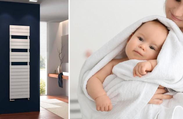 Bébé confortablement enveloppé dans une serviette préalablement chauffée par un sèche-serviette
