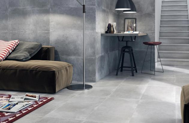 Salon moderne équipé de carreaux Tau Ceramica à l'effet béton