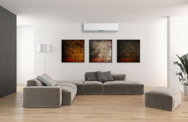 Climatiseur design blanc installé dans un séjour