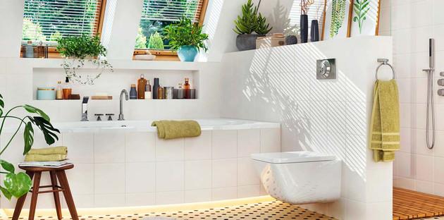 salle de bains et toilettes blancs avec quelques touches de vert