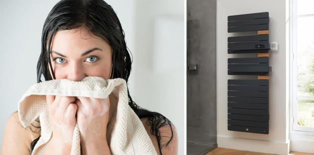 Personne s'enveloppant dans une serviette chaude grâce à un sèche serviette